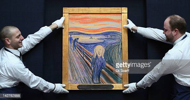 Gallery technicians at Sotheby's auction house adjust 'The Scream' by Edvard Munch on April 12 2012 in London England The iconic painting is on...