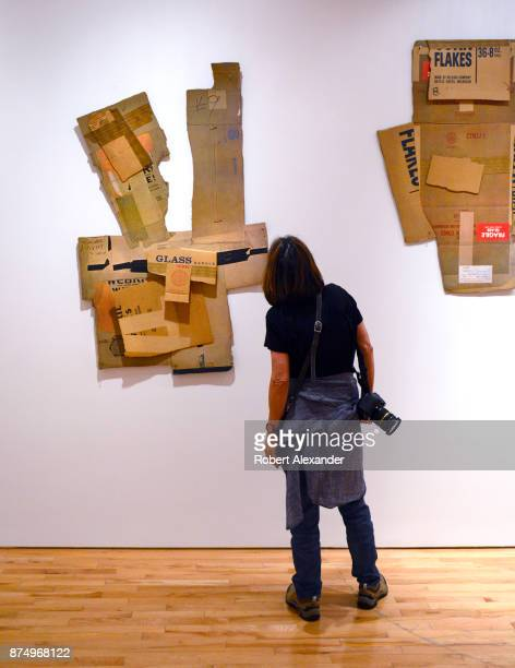 A gallery visitor admires cardboard box collages by Robert Rauschenberg on display and for sale at Gemini GEL art gallery and art publisher in the...