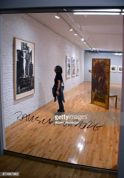A gallery visitor admires prints by Robert Rauschenberg on display and for sale at Gemini GEL art gallery and art publisher in the Chelsea district...
