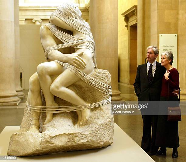 Gallery visitors look at Auguste Rodin's The Kiss wrapped in a mile of string by artist Cornelia Parker at the Tate Britain February 26 2003 in...