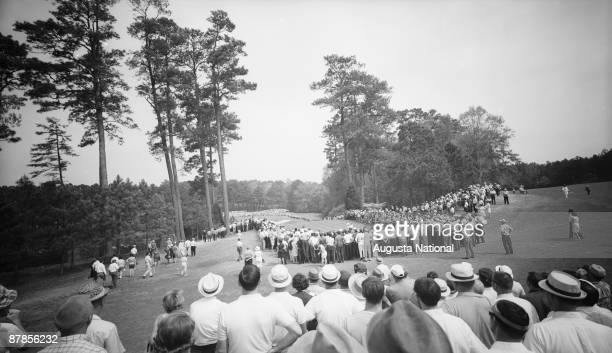 A gallery watches the action off the sixth tee during the 1965 Masters Tournament at Augusta National Golf Club in April 1965 in Augusta Georgia