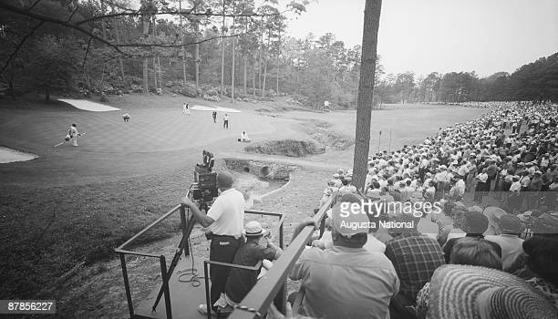 A gallery watches tournament play on the 13th hole during the 1965 Masters Tournament at Augusta National Golf Club in April 1965 in Augusta Georgia