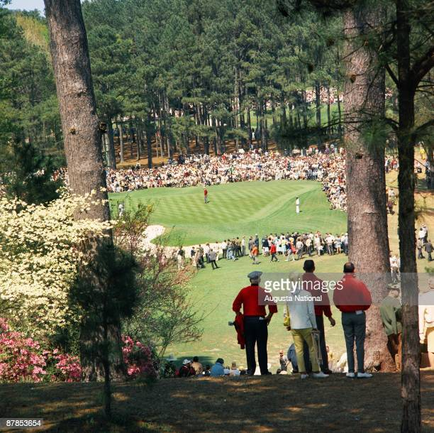 A gallery watches tournament play on the sixth hole during the 1966 Masters Tournament at Augusta National Golf Club in April 1966 in Augusta Georgia