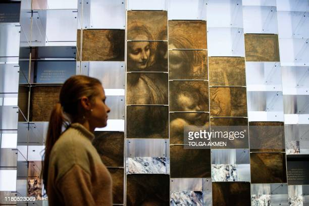 A gallery worker poses during a photocall for the upcoming 'Leonardo Experience a Masterpiece' exhibition at the National Gallery in London on...