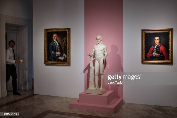 A gallery worker steps out of a room with a coffee beside 'Ritratto di William Rouet precettore della famiglia Hope' by Louis Gabriel Blanchet a...