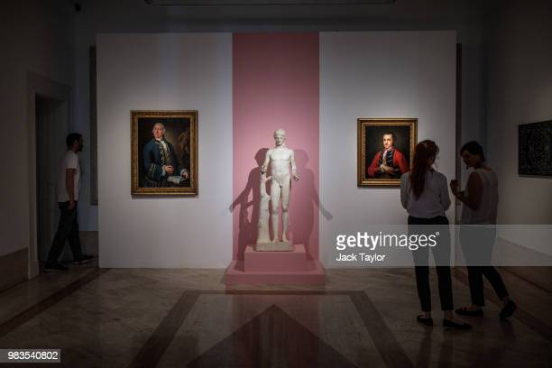 Gallery workers stand in front of 'Ritratto di William Rouet precettore della famiglia Hope' by Louis Gabriel Blanchet a marble statue titled 'The...