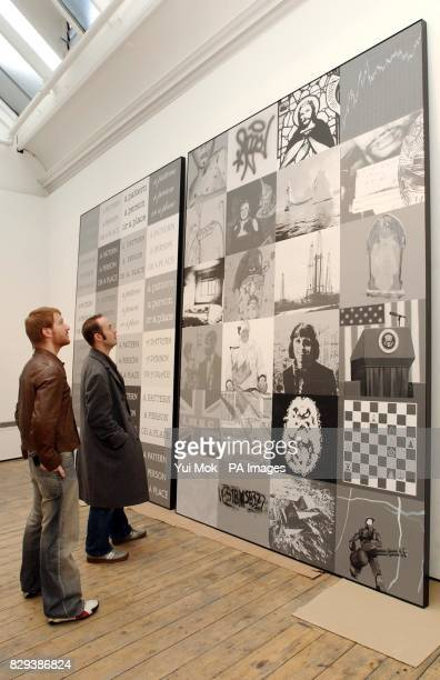 Gallery worker's view the new painting by Turner Prize winning artist Keith Tyson entitled 'The Bigger Picture Emerges' at the Haunch of Venison...