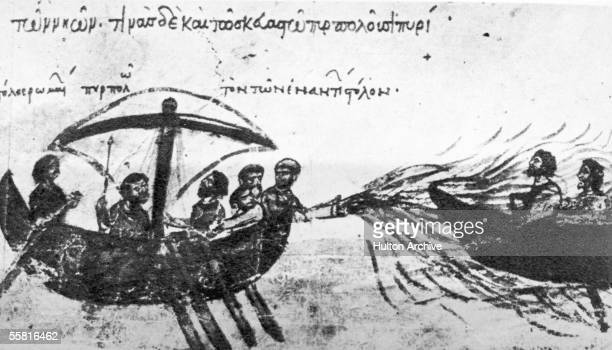 Galley of the Byzantine navy envelops an enemy vessel in 'Greek Fire', a process of spraying burning fluid through a tube, circa 900 AD. The...