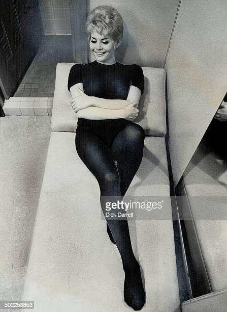 Gallic beauty Noelle Adam; Father Chaplin Is Lovely Man