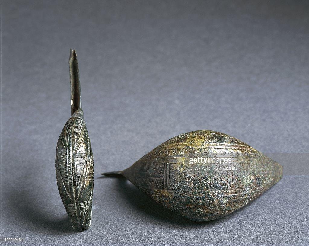 Fibulas in shape of boats : News Photo