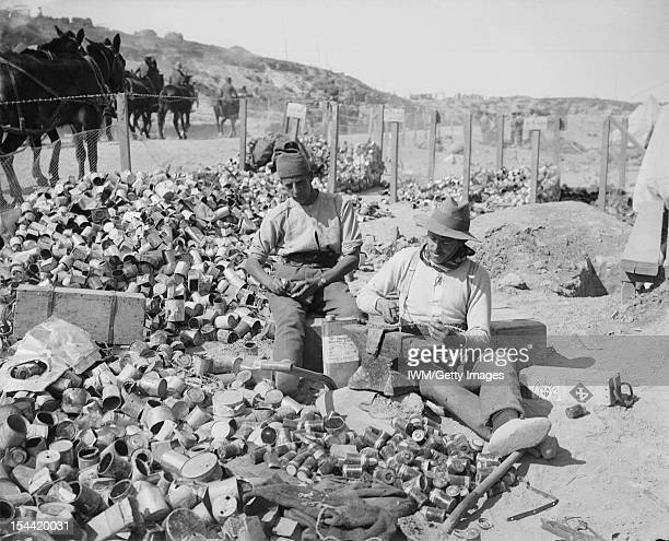 Gallipoli 1915 British soldiers making bombs from empty jam tins filled with scraps of metal barbed wire and shell fragments circa 1915 They were...