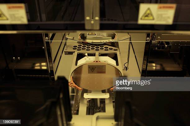A Gallium Arsenide semiconducting wafer is processed into chips for radio frequency communications devices at RF Micro Devices Inc headquarters in...