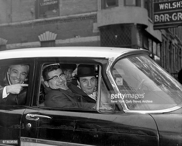 Gallo gang boys Frank Illiano Joseph Musemeci and Albert Gallo Jr laugh as they drive from Bay Ridge Magistrate's Court Brooklyn Charged with...