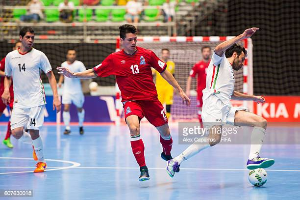 Gallo of Azerbaijan and Ahmad Esmaeilpour of Iran compete for the ball during the FIFA Futsal World Cup Group F match between Azerbaijan and Iran at...
