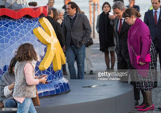 Gallo Worldwide CEO Pedro Cruz and Portuguese artist Joana Vasconcelos read the plaque at the sculpture's base during the inauguration of Pop Galo...