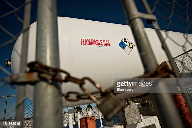 A 30000 gallon tank containing propane sits outside the Michlig Energy Ltd facility in Manlius Illinois US on Thursday Jan 23 2014 Propane in the...