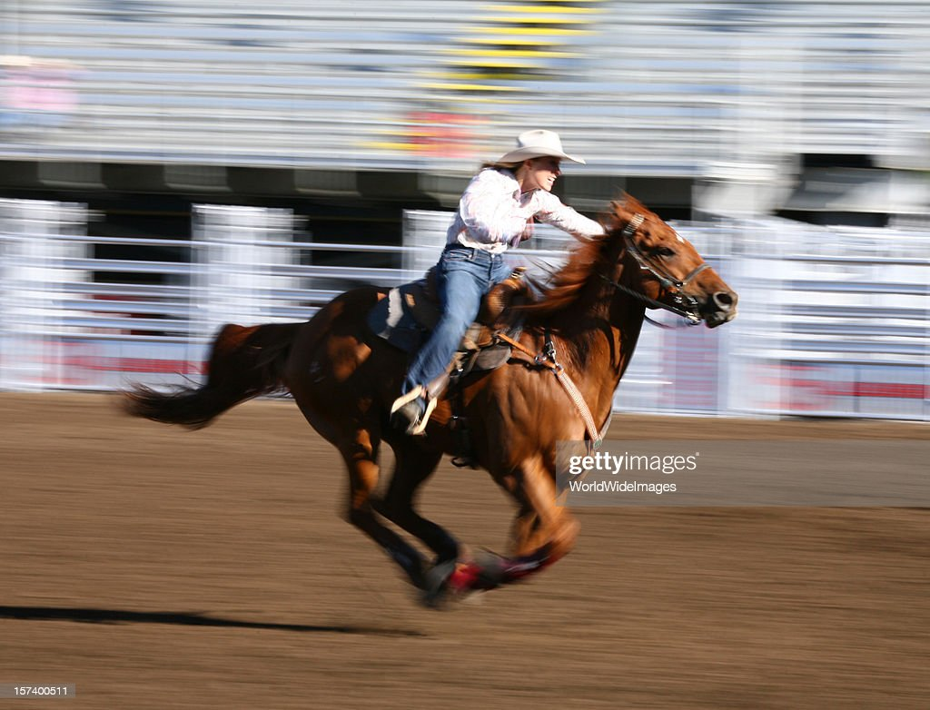 Galloping horse with rider at a rodeo : Stock Photo