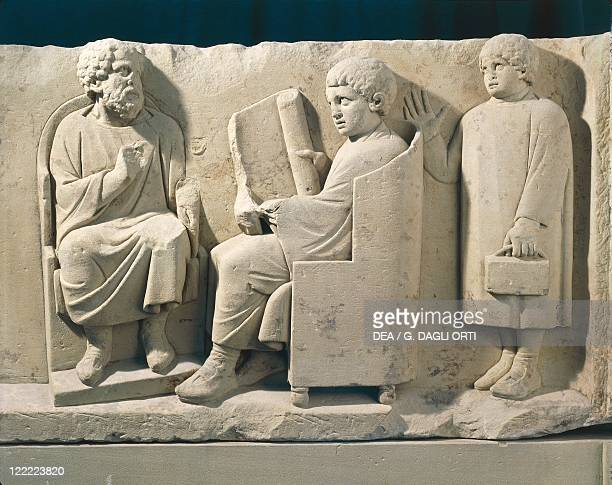 GalloRoman civilization 2nd century AD Stone burial monument with relief representing Neumagen school with teacher and pupils about 180