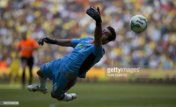 Gallos Blancos's goalkeeper Sergio Garcia attemps to stop the ball during their Clausura 2013 Mexican tournament football match against America at...