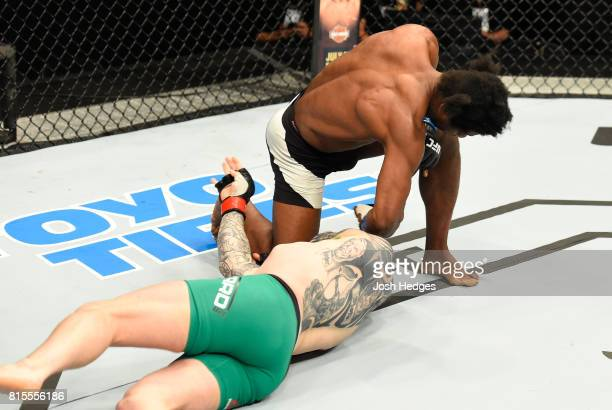 Galore Bofando of England punches Charlie Ward of Ireland in their welterweight bout during the UFC Fight Night event at the SSE Hydro Arena Glasgow...