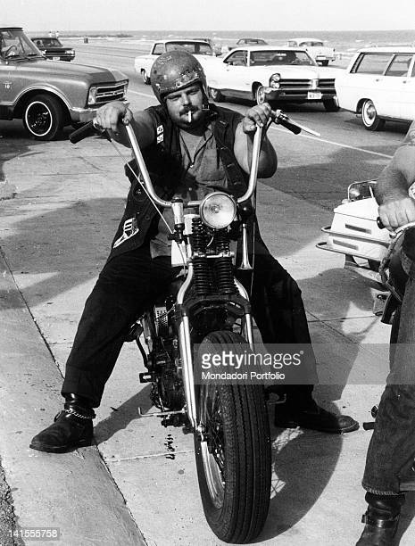 A Galveston 'Bandido' or a Texan boy who's inspired by the Californiabased Black Angels gang sitting on his motorcycle Texas USA September 1969