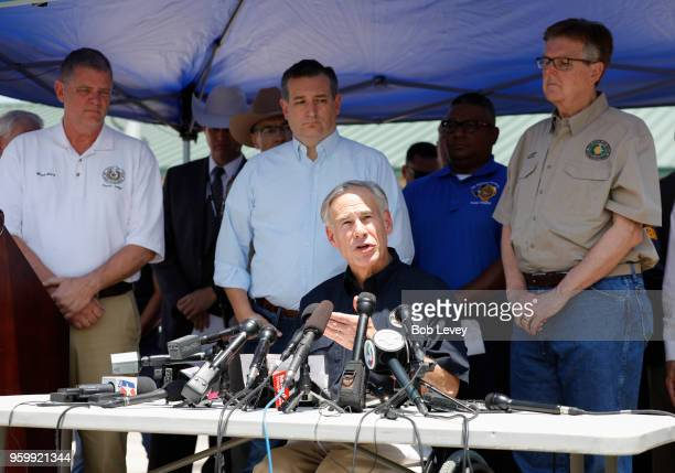 Galveston County Judge Mark Henry SenTed Cruz Texas Gov Greg Abbott and Texas Lt Gov Dan Patrick speak to the media during a press conference about...