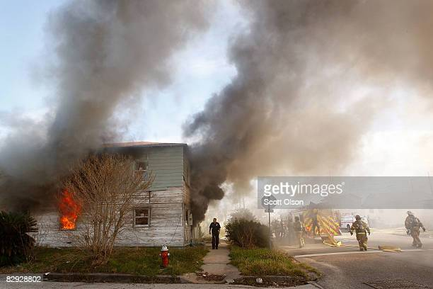 Galveston fire fighters respond to a house fire at a home that was heavily damaged during Hurricane Ike September 20 2008 in Galveston Texas...