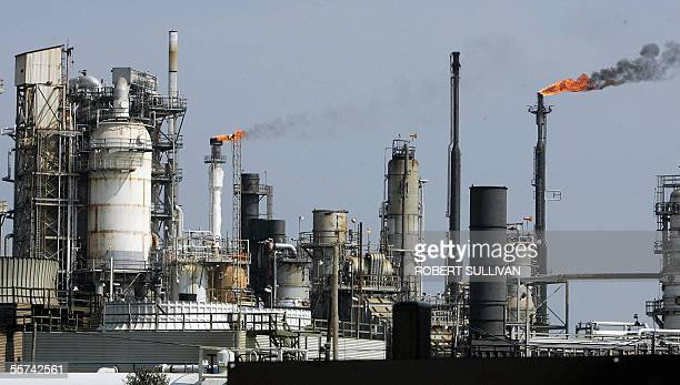 An oil refinery is pictured 22 September 2005 on Galveston Bay in Texas City TX Hurricane Rita threatens a large portion of the US oil and gas...