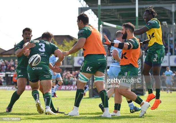 Galway , Ireland - 1 September 2018; Finlay Bealham of Connacht is congratulated by team-mates after scoring his side's second try during the...