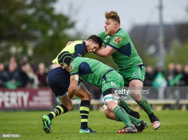 Galway , Ireland - 15 April 2017; Ross Byrne of Leinster is tackled by Jake Heenan, left, and Finlay Bealham of Connacht during the Guinness PRO12...