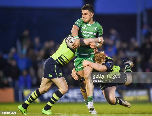 Galway Ireland 15 April 2017 Tiernan OHalloran of Connacht is tackled by Barry Daly left and James Tracy of Leinster during the Guinness PRO12 Round...