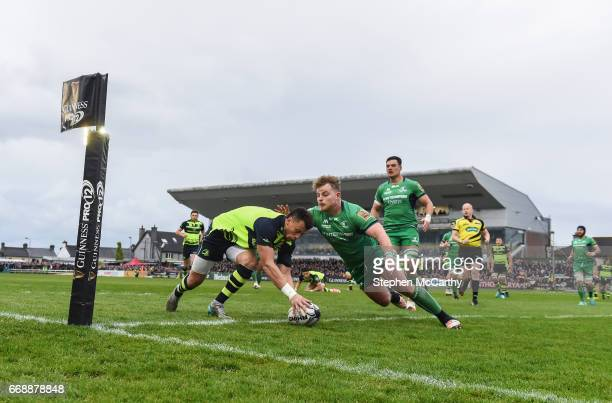 Galway , Ireland - 15 April 2017; Zane Kirchner of Leinster goes over to score his side's first try despite the attention of Finlay Bealham of...