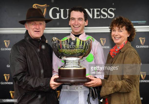 Galway Ireland 2 August 2018 Jockey Patrick Mullins celebrates with father and trainer Willie and mother Jackie after winning the Guinness Galway...