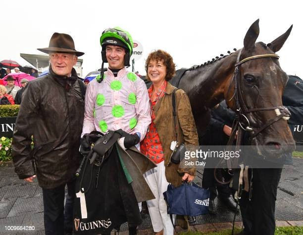 Galway Ireland 2 August 2018 The Mullins family from left trainer Willie Mullins jockey Patrick Mullins and mother Jackie Mullins after winning the...