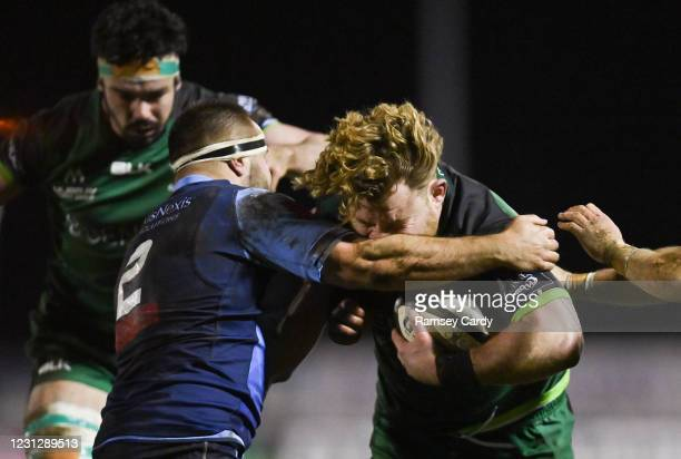 Galway , Ireland - 20 February 2021; Finlay Bealham of Connacht is tackled by Liam Belcher of Cardiff Blues during the Guinness PRO14 match between...