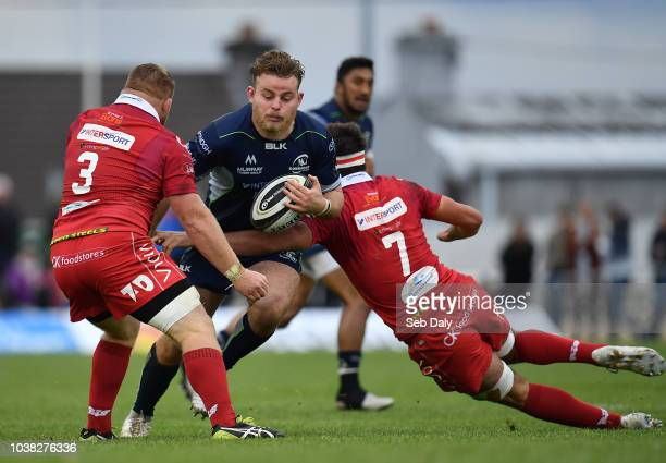 Galway , Ireland - 22 September 2018; Finlay Bealham of Connacht is tackled by Samson Lee, left, and Lewis Rawlins of Scarlets during the Guinness...