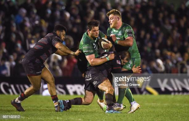 Galway , Ireland - 23 March 2018; Quinn Roux of Connacht, supported by team-mate Finlay Bealham, is tackled by Darryl Marfo, left, and Neil Cochrane...