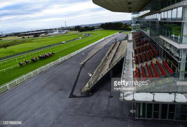 Galway , Ireland - 27 July 2020; A general view as runners and riders pass the empty Killanin Stand during the Monami Construction Maiden on day one...