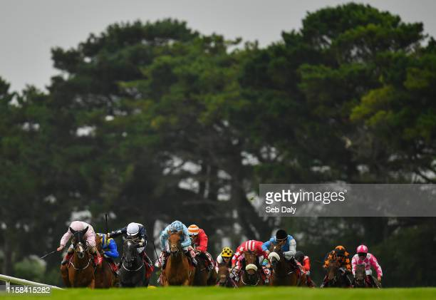 Galway Ireland 29 July 2019 Eventual winner Galtee Mist left with Colm O'Donoghue up on their way to winning the Claytonhotelgalwayie Handicap during...