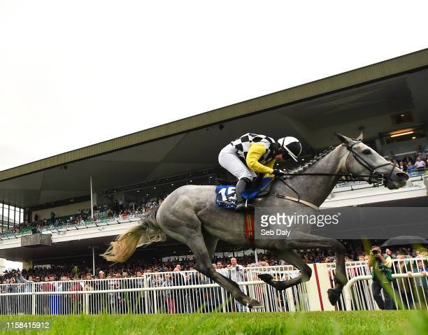 Galway Ireland 29 July 2019 Great White Shark with Jody Townend up crosses the line to win the Connacht Hotel Handicap during Day One of the Galway...