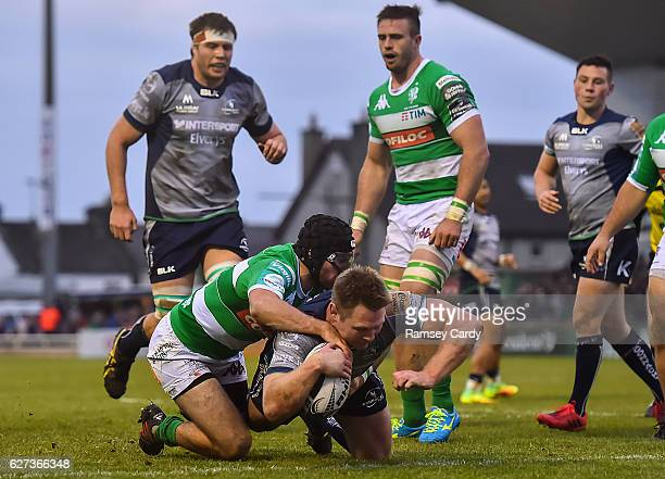 Galway Ireland 3 December 2016 Tom McCartney of Connacht scores his side's third try despite the tackle of Ian McKinley of Treviso during the...