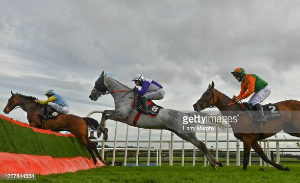 Galway , Ireland - 30 July 2020; Cooldine Bog, left, with Cathal Landers up, who finished sixth, Cherif De L'isle, centre, with Denis O'Regan up, who...