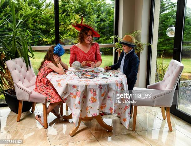 Galway Ireland 30 July 2020 Michelle Drysdale from Craughwell in Galway with her children Grace aged nine and Matthew aged seven play Monopoly in...