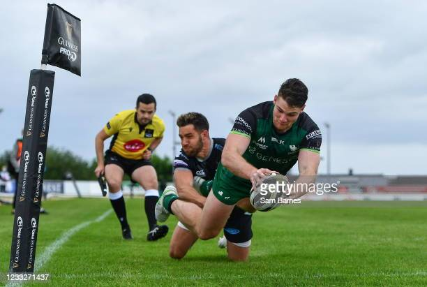 Galway , Ireland - 4 June 2021; Peter Sullivan of Connacht dives over the line to score his side's fourth try despite the efforts of Rhys Webb of...