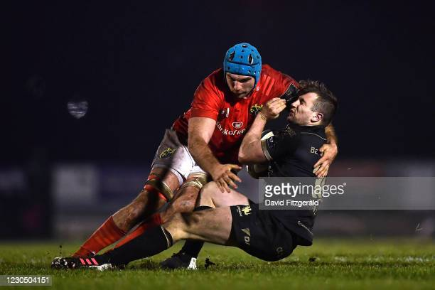 Galway , Ireland - 9 January 2021; Jack Carty of Connacht is tackled by Tadhg Beirne of Munster during the Guinness PRO14 match between Connacht and...