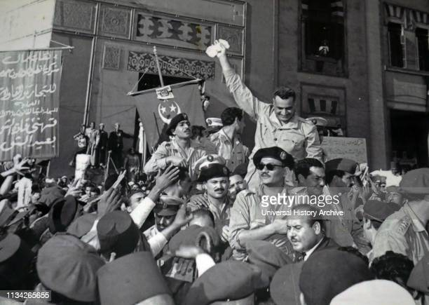 Gamal Abdel Nasser and members of the RCC welcomed by cheering crowds in Alexandria 1954 after the signing of the British withdrawal order Kamal...