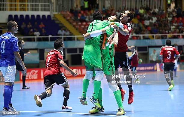 Gamal Abdelnaser Mohamed Abdellatif and Mohamed Mido of Egypt celebrate victory during the FIFA Futsal World Cup Round of 16 match between Italy and...