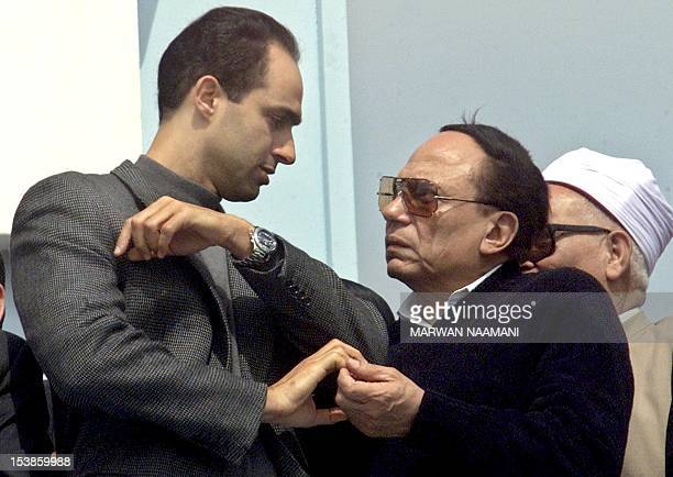 Gamal Mubarak son of Egyptian President Hosni Mubarak speaks to Egypt's top comedian Adel Imam during a rally organised by the ruling Democratic...
