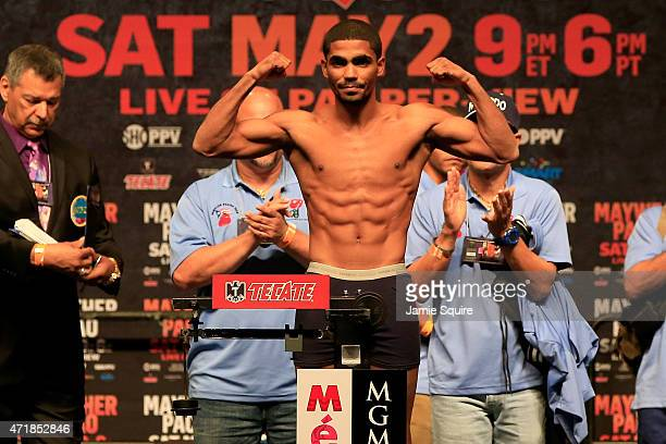 Gamalier Rodriguez poses as he steps on the scale during his official weighin for his bout against Vasyl Lomachenko on May 1 2015 at MGM Grand Garden...
