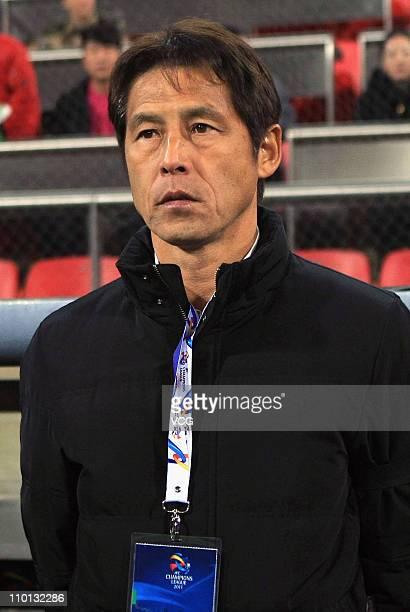 Gamba Osaka coach Akira Nishino looks on during the AFC Champions League Group E match between the Tianjin Teda and Gamba Osaka at Tianjin Teda...